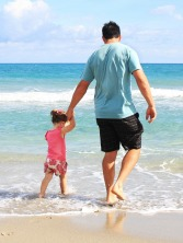 father-daughter-beach-sea-38302.jpg